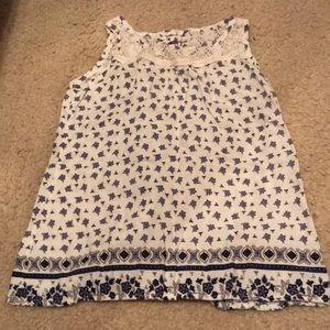 A purple, white, &dark blue flower pattern shirt